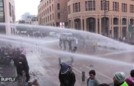 Lebanon-Police-Fire-Water-Cannon-Protesters-Hurl-Tree-Branches-in-Beirut